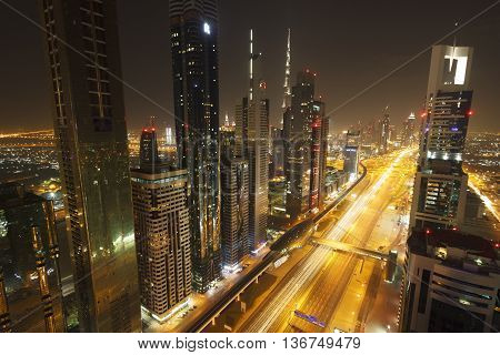 Dubai, United Arab Emirates - January 10, 2013: View of Sheikh Zayed Road skyscrapers in Dubai, UAE. More than 25 skyscrapers can be found here.