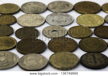 Closeup of many old coins on white background