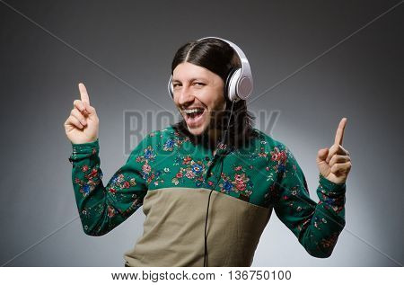 Young man with headphones in DJ concept