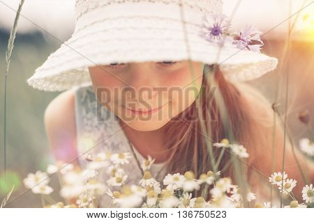 Caucasian Girl Exploring the Nature. Journey Into the Summer Meadow.
