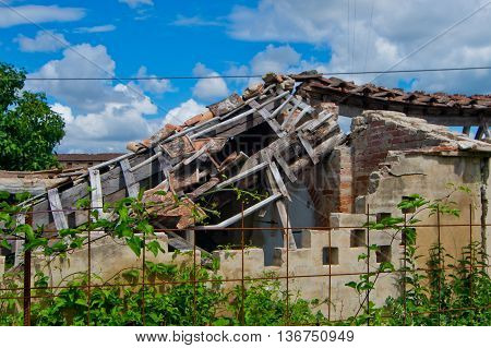 roof collapsed and destroyed of an old run down building