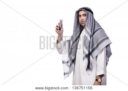 Arab man with his mobile phone isolated on white