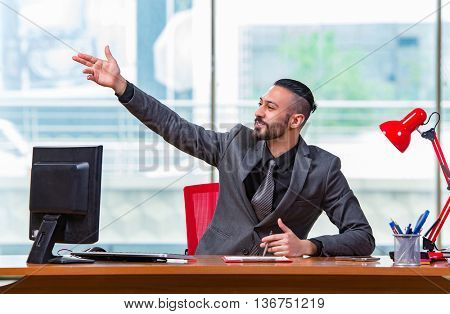 Businessman cheering saluting in the office