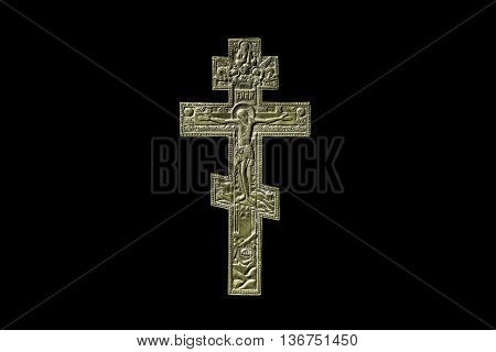 Ancient orthodox iron cross on black background isolated
