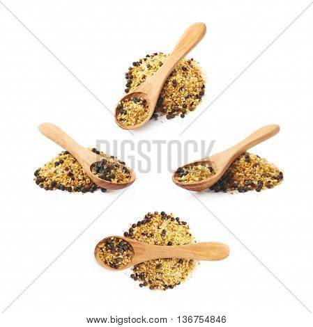 Wooden spoon over the pile of garlic and pepper seasoning isolated over the white background, set collection of four different foreshortenings
