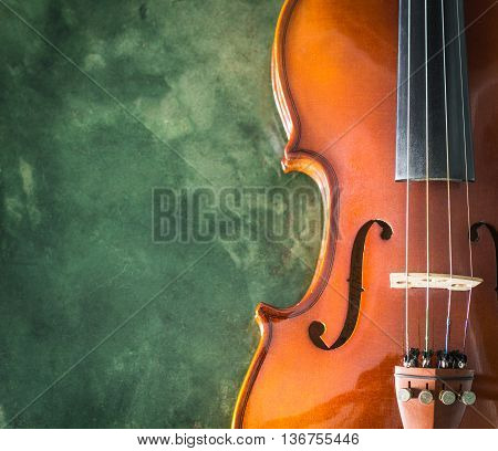 Violin on green cement background with Copy Space on the Right Side.