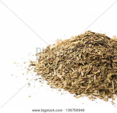 Pile of dry mate tea leaves isolated over the white background