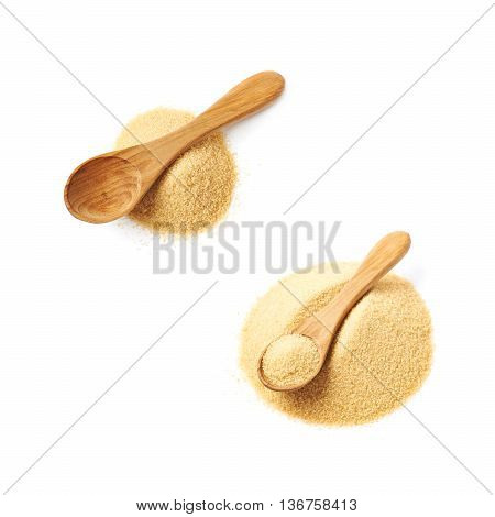 Wooden spoon over the pile of stevia cane sugar isolated over the white background, set of two different foreshortenings