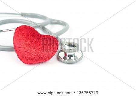 Stethoscope and red hearth on white background