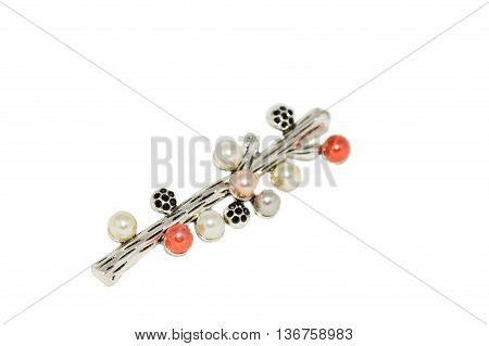 brooch in the shape of a branch isolated on a white background