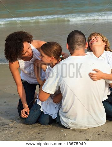 Young Family on the beach having fun