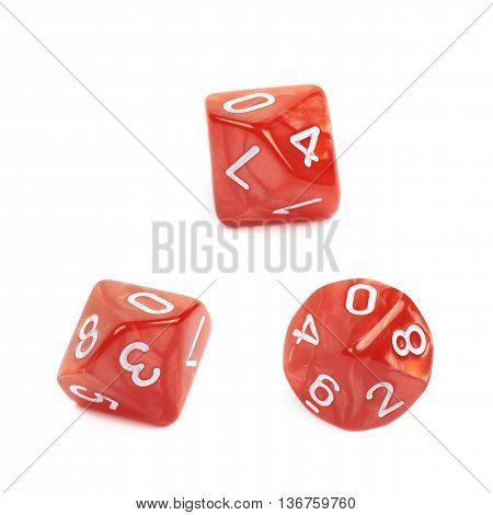 Red roleplaying polyhedral heptagonal trapezohedron gaming plastic dice isolated over the white background, set of three different foreshortenings