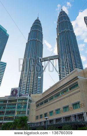 KUALA LUMPUR MALAYSIA - FEBRUARY 29: Petronas Twin Towers during evening on February 29 2016 in Kuala Lumpur Malaysia. Petronas Twin Towers with Suria KLCC Mall.