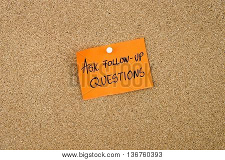Ask Follow-up Questions Written On Orange Paper Note