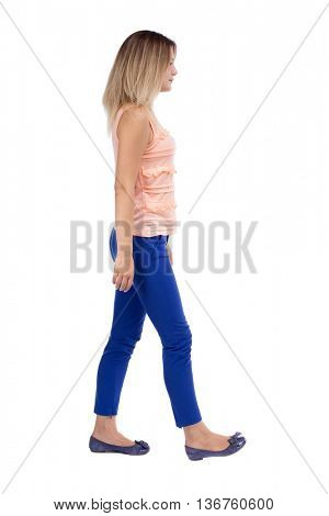 back view of walking  woman. beautiful blonde girl in motion.  backside view of person.  Rear view people collection. Isolated over white background.The blonde in a pink blouse is left.