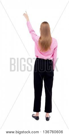 Back view of  pointing woman. beautiful girl. Rear view people collection.  backside view of person.  Isolated over white background. A woman in a red shirt with long sleeves points to the sky.