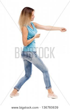 back view of standing girl pulling a rope from the top or cling to something. Rear people collection.  backside of person.  Isolated over white background.
