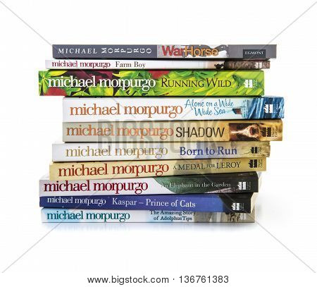 SWINDON UK - JULY 11 2016: Collection of books by Michael Morpurgo on a white background