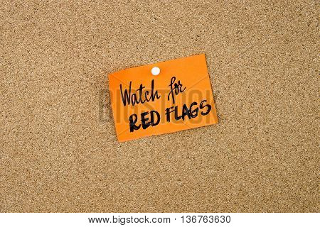 Watch For Red Flags Written On Orange Paper Note