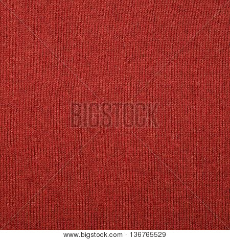 Fragment of a red cloth fabric material texture as an abstract background composition