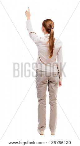 Back view of  pointing woman. beautiful girl. Rear view people collection.  backside view of person.  Isolated over white background. A girl standing in a light suit and jeans showing thumbs up.