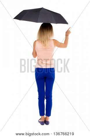 pointing  woman  under an umbrella. Rear people collection.  backside of person.  Isolated over white background. The girl under an umbrella stands and points at something interested.