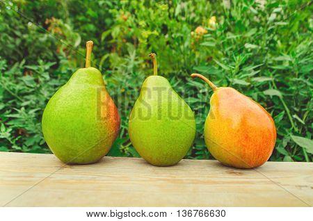 Fresh sweet organic pears on old wood.