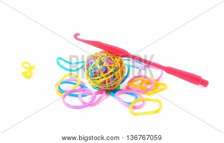 Pile of multiple colorful rubber toy loom bands isolated over the white background