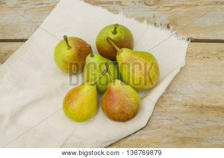 Tasty natural  pears.  Pears on a rustic wooden table