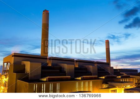 Concrete cement factory at night