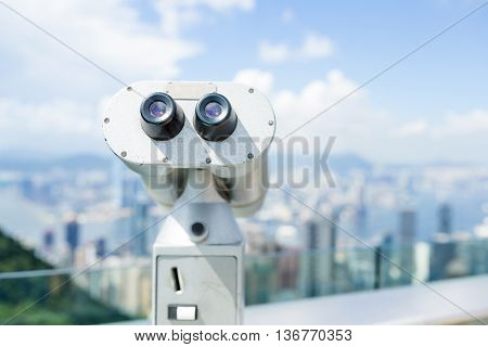 Tourist binocular with background of Hong Kong city