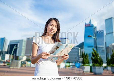 Young woman holding city map