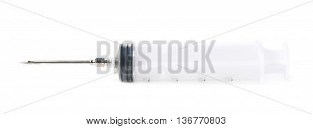 Two oz syringe isolated over the white background