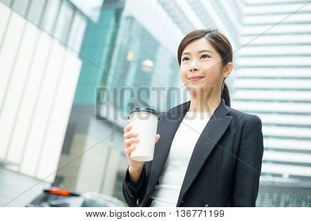 Young businesswoman holding a coffee