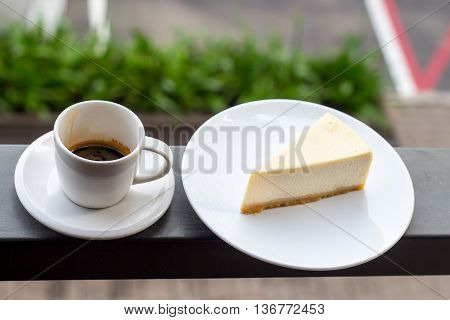 Cheesecake. Slice of Plain New York Cheesecake on white plate.Cup of art cappuccino coffee.