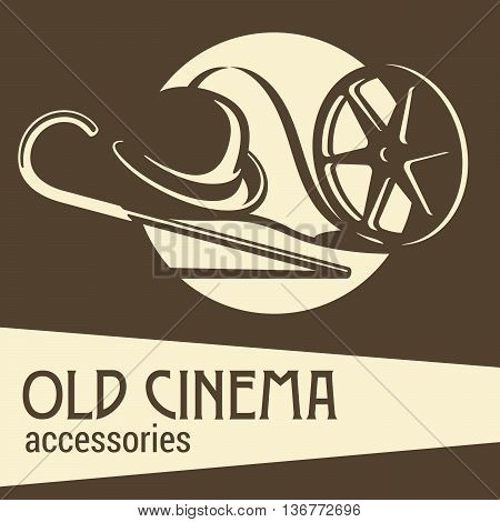 Old cinema accessories. Hat, stick and film.