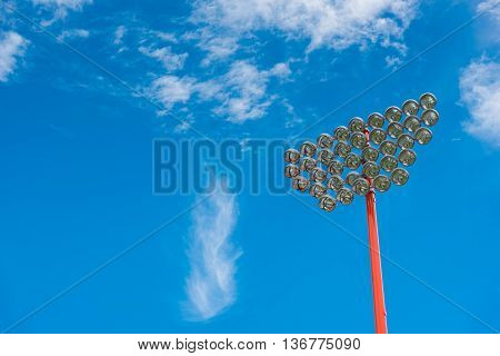 sport light pole with blue sky and cloud background.
