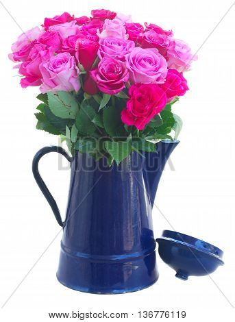 bouquet of pink and magenta fresh roses in blue pot isolated on white background