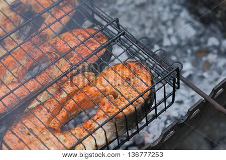 Cooking fish salmon grilled on the grill
