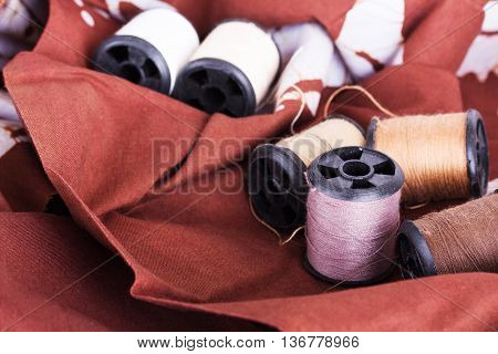 Reels Of Cotton For Sewing On Brown Material