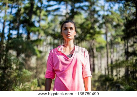 Woman unsmiling posing on the wood