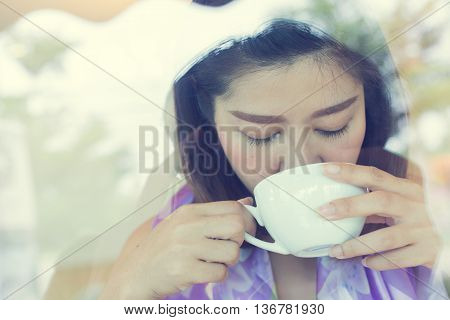 female drinking hot coffee in cafe beautiful asian women portrait model