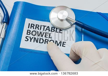 Blue Folder With Patient Files With Ibs (irritable Bowel Syndrom