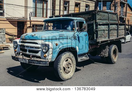 Tbilisi Georgia - July 18 2015.Man drives old rusty Russian ZIL truck in Tbilisi