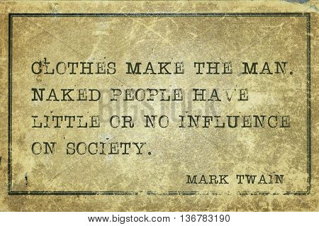 Clothes make the man. Naked people have little or no influence - famous American writer Mark Twain quote printed on grunge vintage cardboard