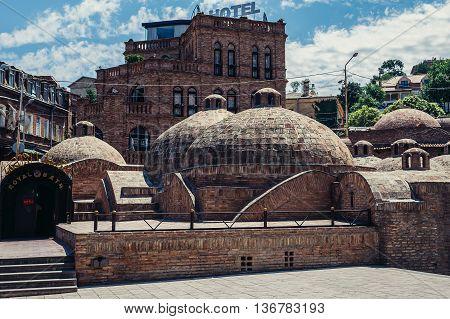 Tbilisi Georgia - July 18 2015. Domes of public sulphur baths in Abanotubani area of Tbilisi