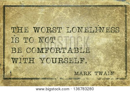 The worst loneliness is to not be comfortable with yourself - famous American writer Mark Twain quote printed on grunge vintage cardboard