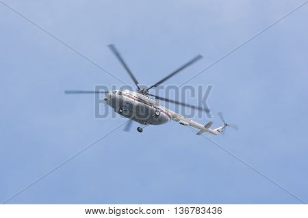 Anapa Russia - March 10 2016: Russian helicopter Mi-8 MTV-1 in flight in the colors of the Russian Emergencies Ministry