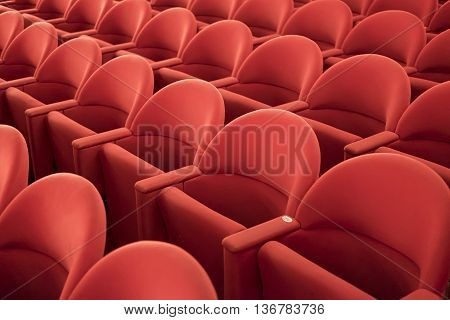 Typical theater empty red seats in row.