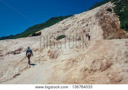 Caucasus Mountains Georgia - July 20 2015. Tourists walks on limestone form called travertine next to Georgian Military Highway in Georgia